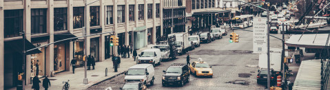 Commercial Rentals: Image of Manahattan Street Scene with Several Taxis Approaching a Crossection