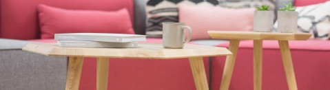 View Rentals: Image of a Decorative Coffee Table with Seating in the Background